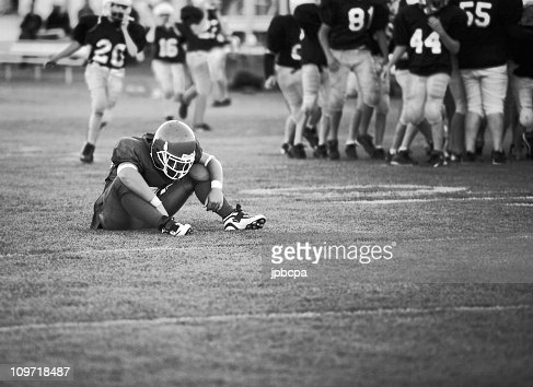 Football Player Sitting on Field