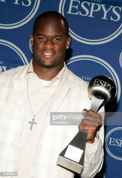 Football player Vince Young poses in the press room with the award for 'Best Championship Performance' at the 2006 ESPY Awards at the Kodak Theatre...