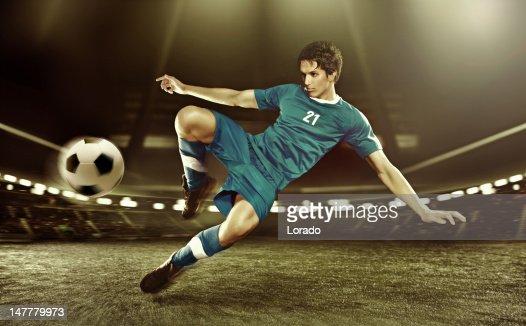 football player volleying ball : Stock Photo