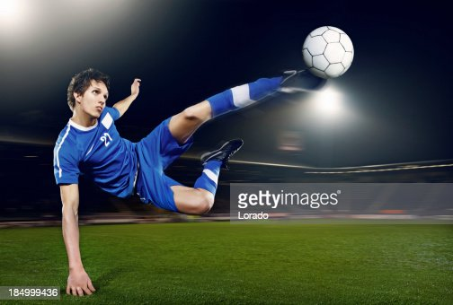 football player volleying ball
