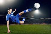 football player volleying ball