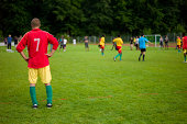 Football player watching his team