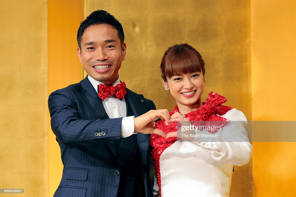 Football player Yuto Nagatomo and actress Airi Taira pose for photographs during a press conference announcing their engagement on December 24, 2016 in Tokyo, Japan.