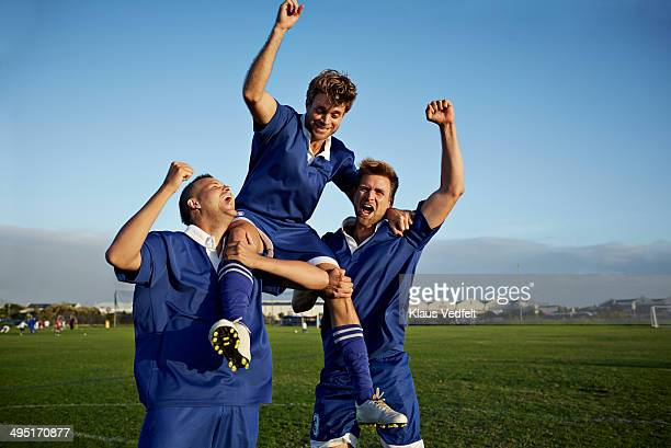 Football players cheering after goal