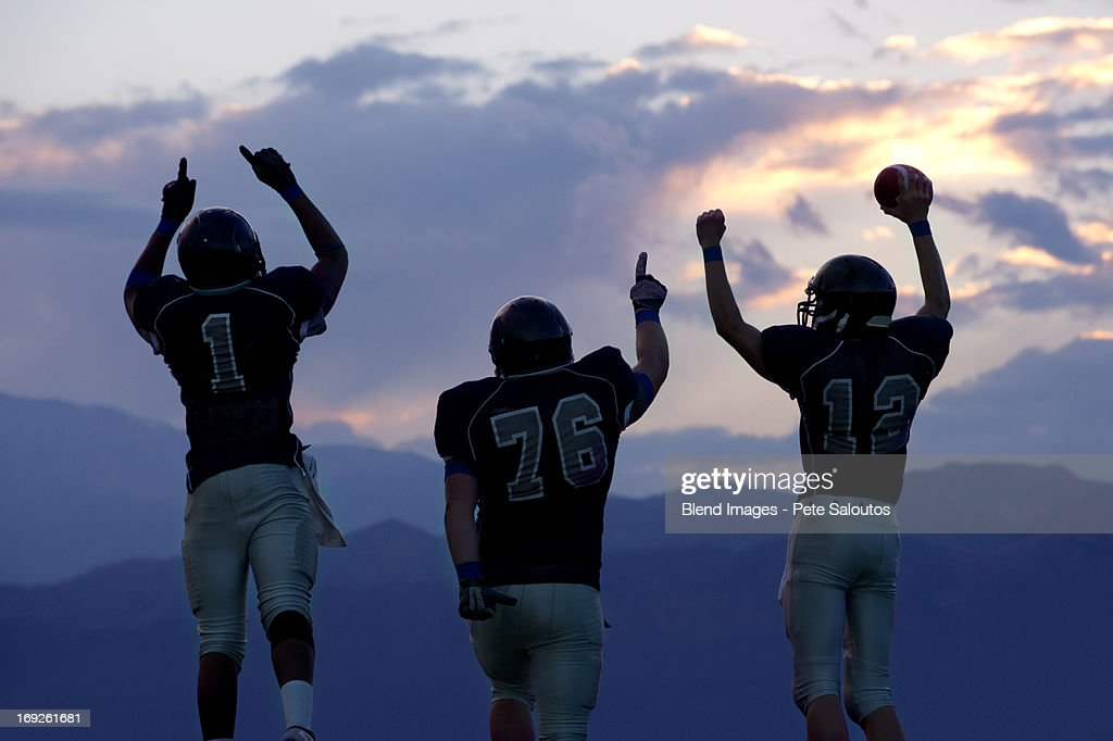 Football players cheering in game
