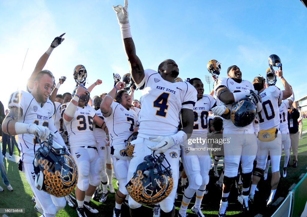 Football players from the Kent State Golden Flashes celebrate after a game with the Bowling Green Falcons at Dolt L. Perry Stadium in Bowling Green, Ohio. The Kent State Golden Flashes won 31-24.