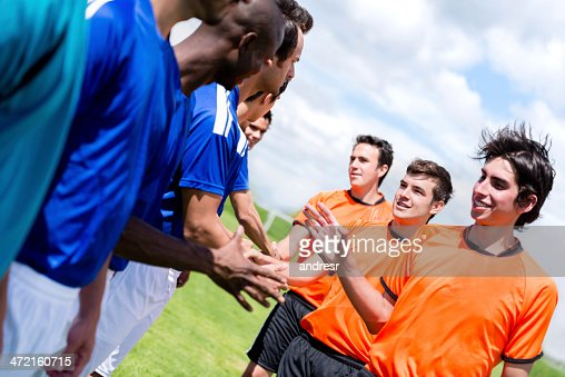 Football players handshaking : Stock Photo