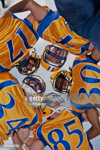 Football players in huddle : Stock Photo