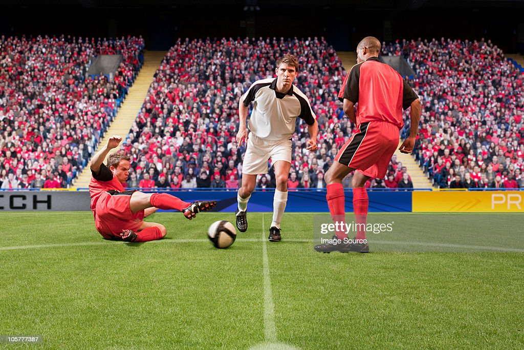 Football players kicking the ball : Stock Photo