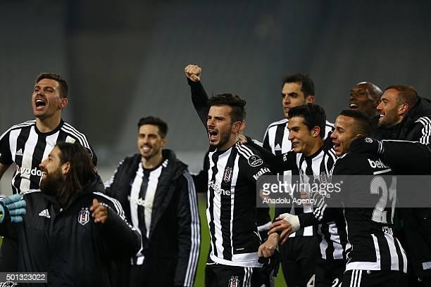 Football players of Besiktas celebrate after winning the Turkish Spor Toto Super League football match between Besiktas and Galatasaray at Ataturk...