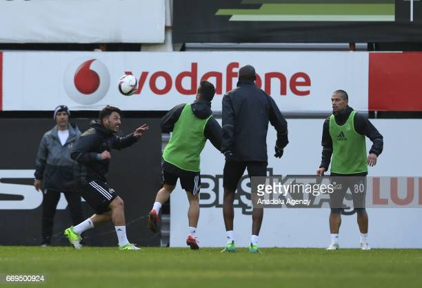 Football players of Besiktas take part in the training session ahead of the UEFA Europa League second leg quarter final football match between...