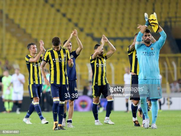 Football players of Fenerbahce greet their fans after their victory at the end of the UEFA Europa League third qualifying round 2nd leg match between...