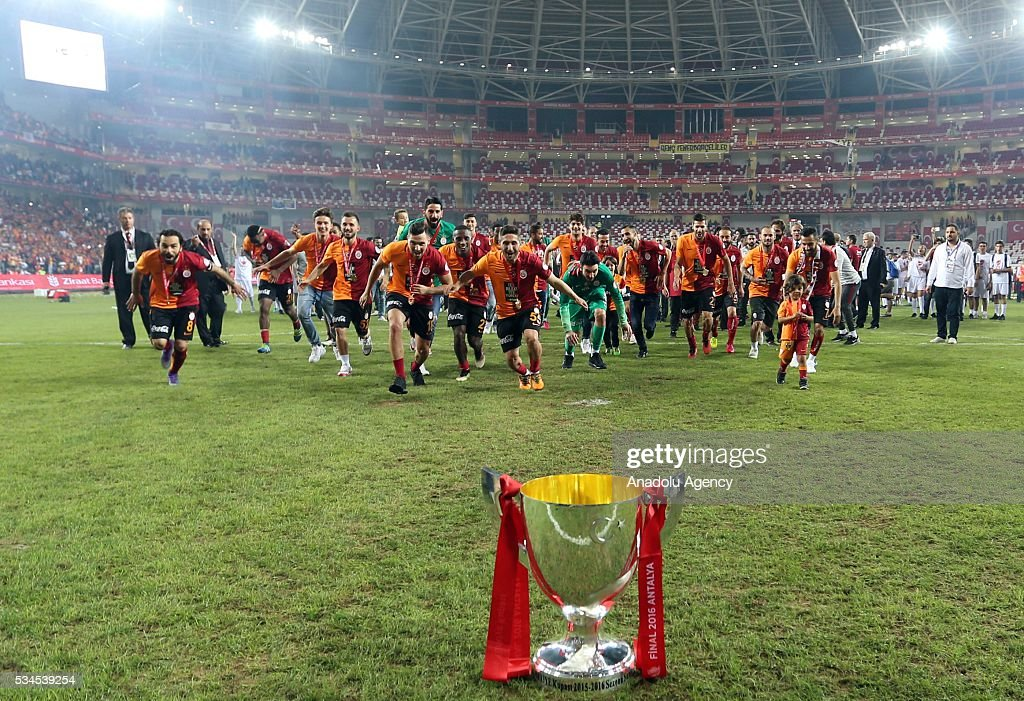 Football players of Galatasaray celebrate their victory after they won the Ziraat Turkish Cup Final match between Galatasaray and Fenerbahce at Antalya Ataturk Stadium in Antalya, Turkey on May 26, 2016.