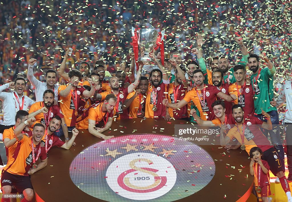 Football players of Galatasaray raise the trophy after they won the Ziraat Turkish Cup Final match between Galatasaray and Fenerbahce at Antalya Ataturk Stadium in Antalya, Turkey on May 26, 2016.