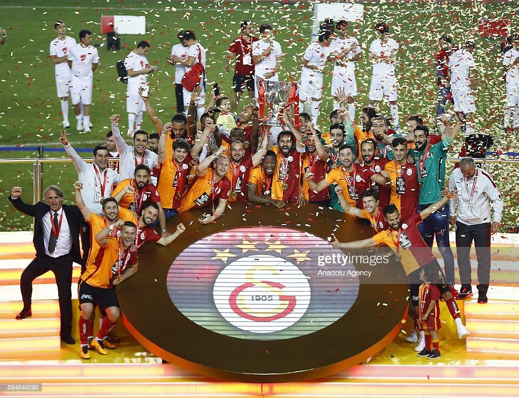 Football players of Galatasaray raise the trophy after they won the Ziraat Turkish Cup Final match between Galatasaray and Fenerbahce at Antalya Ataturk Stadium in Antalya, Turkey on May 26, 2016.