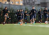 Football players of Medipol Basaksehir attend a training session prior to UEFA Champions League third preliminary lap match between Medipol...
