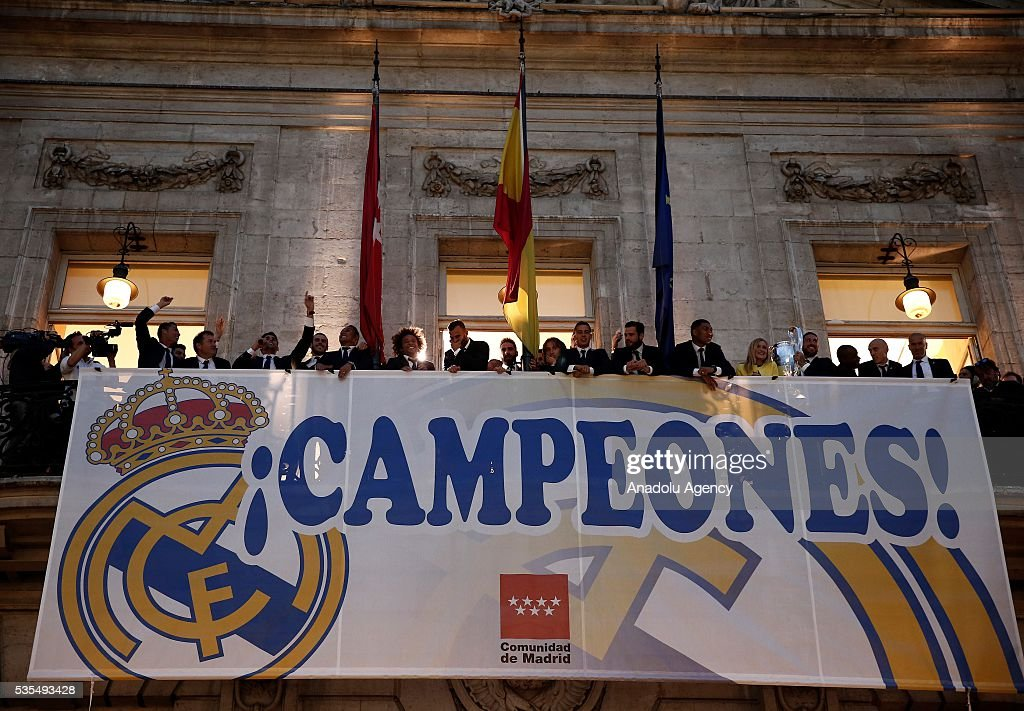Football Players of Real Madrid greets fans from balcony during their visit to President of the Community of Madrid Cristina Cifuentes after Real Madrid won the UEFA Champions League Final match against Club Atletico de Madrid, at Madrid City Hall in Madrid, Spain on May 29, 2016.