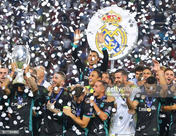 Football Players of Real Madrid raise the trophy after their victory at the end of the UEFA Super Cup final between Real Madrid and Manchester United...