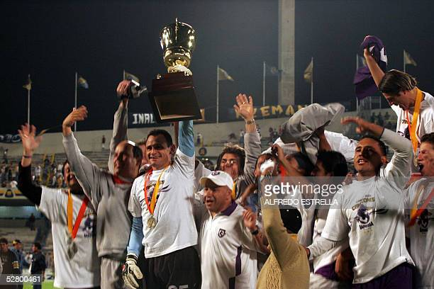 Football players of Saprissa team of Costa Rica celebrates their victory with trophy during the 'Campeon de Campeones y sub campeones' of Concacaf...