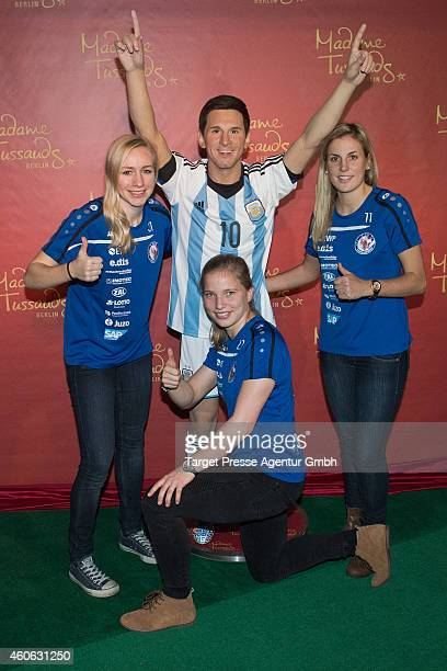 Football players of the national team of Germany Pauline Bremer Tabea Kemme and Jennifer Cramer unveil a new wax figure of football player Lionel...