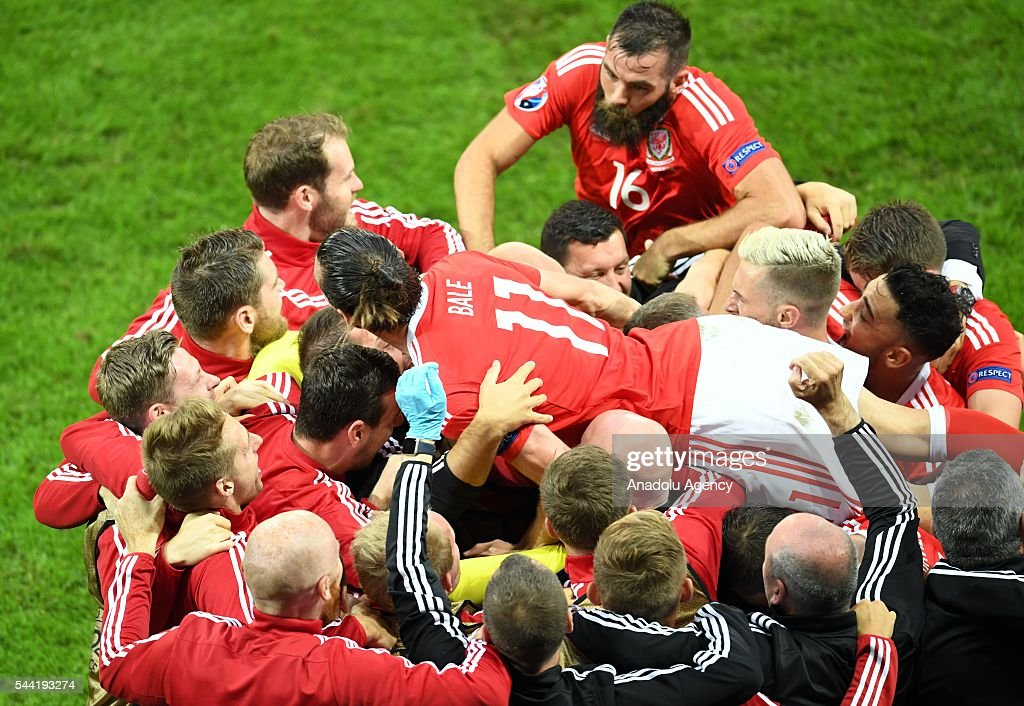 Football players of Wales celebrate after scoring a goal during the Euro 2016 quarter-final football match between Wales and Belgium at the Stadium Pierre Mauroy in Lille, France on July 1, 2016.