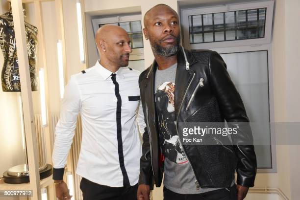 Football players Ousmane Dabo and William Gallas who wears a leather and fish skin jacket pose during the French Deal Cocktail as part of Paris...