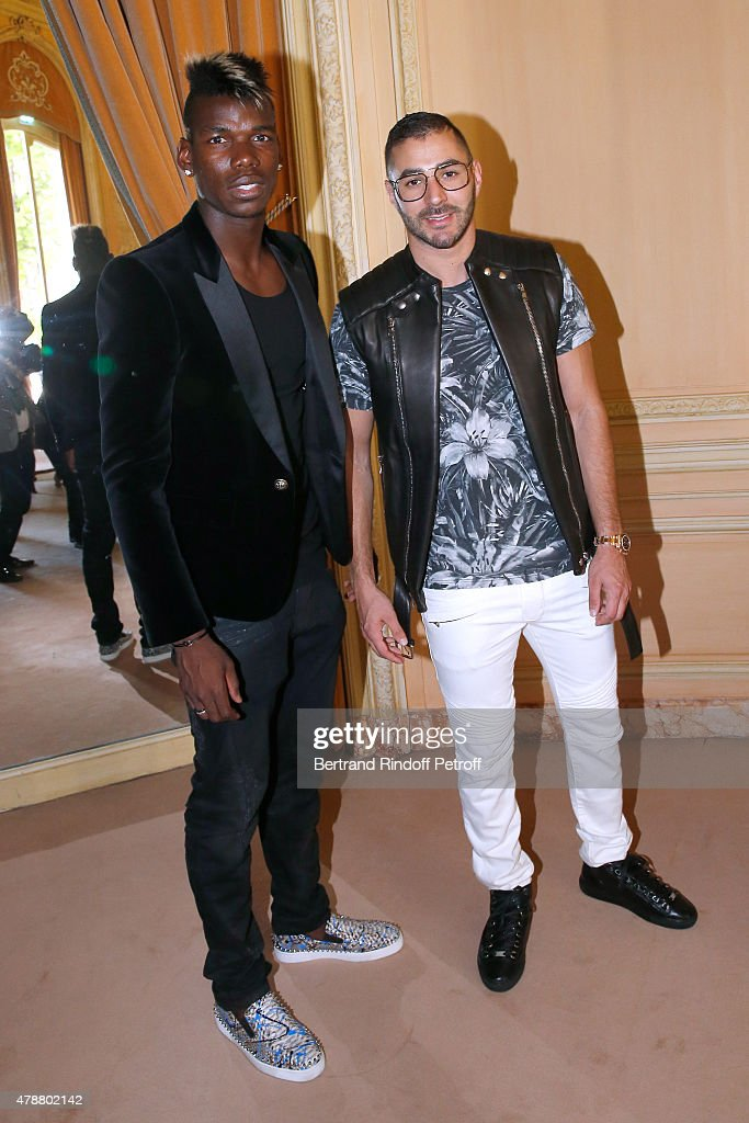 Football Players Paul Pogba and Karim Benzema attend the Balmain Menswear Spring/Summer 2016 show as part of Paris Fashion Week on June 27, 2015 in Paris, France.