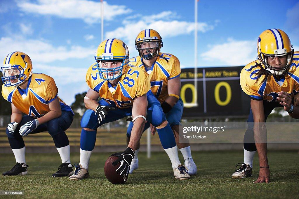 Football players preparing to play football : Stock Photo