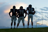 Football players standing on field