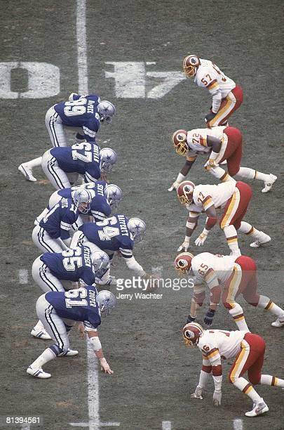 Football playoffs Line of scrimmage during Washington Redskins vs Dallas Cowboys game Washington DC 1/22/1983