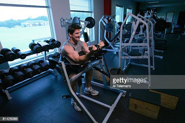 Football Portrait of Atlanta Falcons Keith Brooking in action demonstrating biceps curls during training camp weight workout Flowery Branch GA...