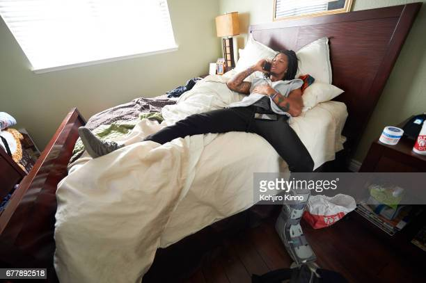 Portrait of former Washington cornerback Sidney Jones lying on bed during Round 2 of the NFL Draft on Friday at home Jones a projected first round...