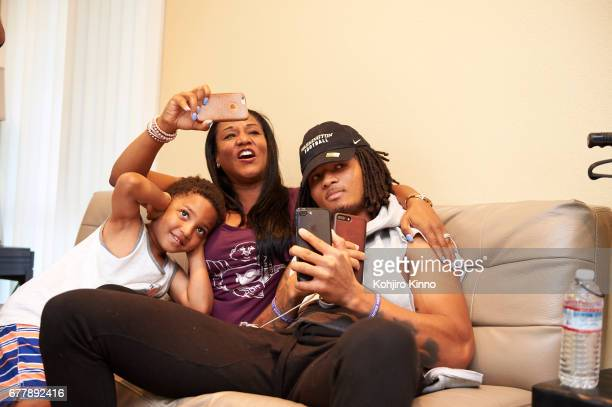 Portrait of former Washington cornerback Sidney Jones with his brother Chance and his mother LaKeysha Pugh while watching Round 2 of the NFL Draft on...