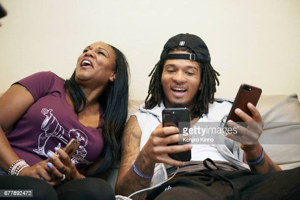 Portrait of former Washington cornerback Sidney Jones with his mother LaKeysha Pugh while watching Round 2 of the NFL Draft on Friday at home Jones a...