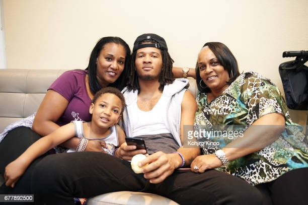 Portrait of former Washington cornerback Sidney Jones with his brother Chance their mother LaKeysha Pugh and their grandmother Helen Watson while...