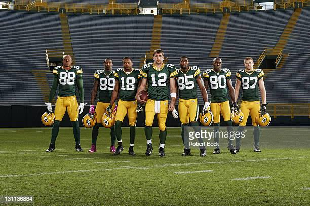 Portrait of Green Bay Packers QB Aaron Rodgers with offense Jermichael Finley James Jones Randall Cobb Greg Jennings Donald Driver and Jordy Nelson...