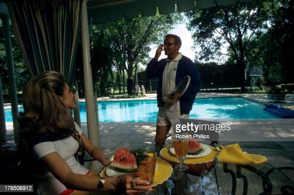 Portrait of Kansas City Chiefs owner Lamar Hunt with wife Norma by the pool during photo shoot outside their Gaywood estate home Dallas TX CREDIT...