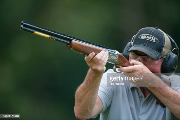 Portrait of Minnesota Vikings head coach Mike Zimmer aiming hunting rifle during photo shoot at home Walton KY CREDIT Bill Frakes