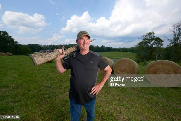 Portrait of Minnesota Vikings head coach Mike Zimmer posing with hunting rifle during photo shoot at home Walton KY CREDIT Bill Frakes