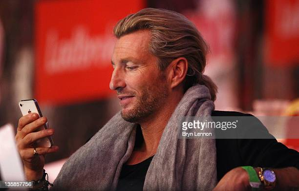 Football pundit Robbie Savage attended day one of the 2012 Ladbrokescom World Darts Championship at Alexandra Palace on December 15 2011 in London...