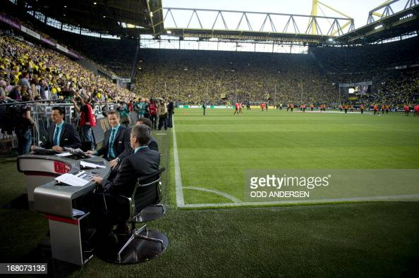 Football pundits for German SKY are seen broadcasting pitch side prior to the German first division Bundesliga football match BVB Borussia Dortmund...