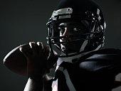 Football quarterback preparing to throw pass