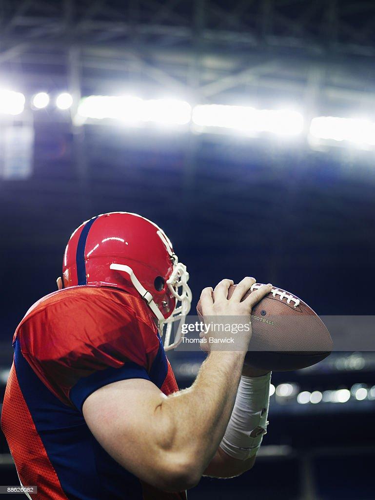 Football quarterback preparing to throw
