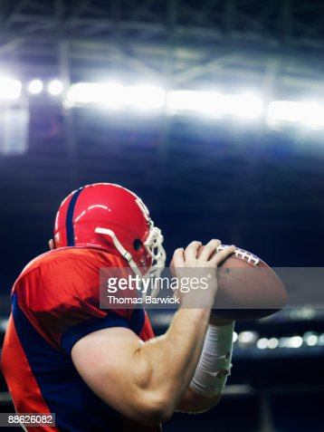 Football quarterback preparing to throw : Stock Photo