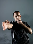 Football referee blowing whistle, portrait