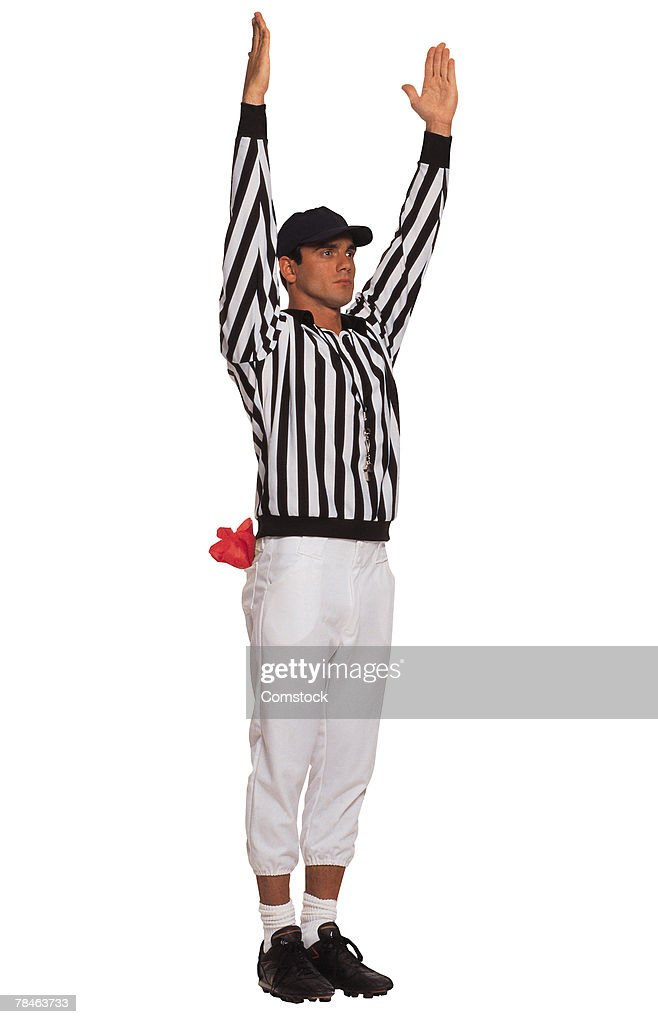 Football referee signaling touchdown