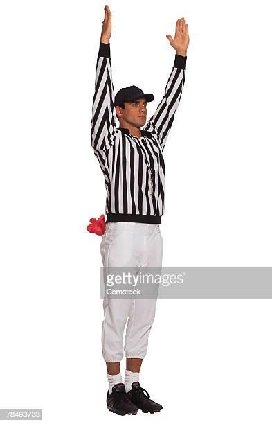 Football referee signaling touchdown