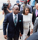 Football running back Adrian Peterson of the Minnesota Vikings arrives for a court hearing on charges of child abuse at the Montgomery County...