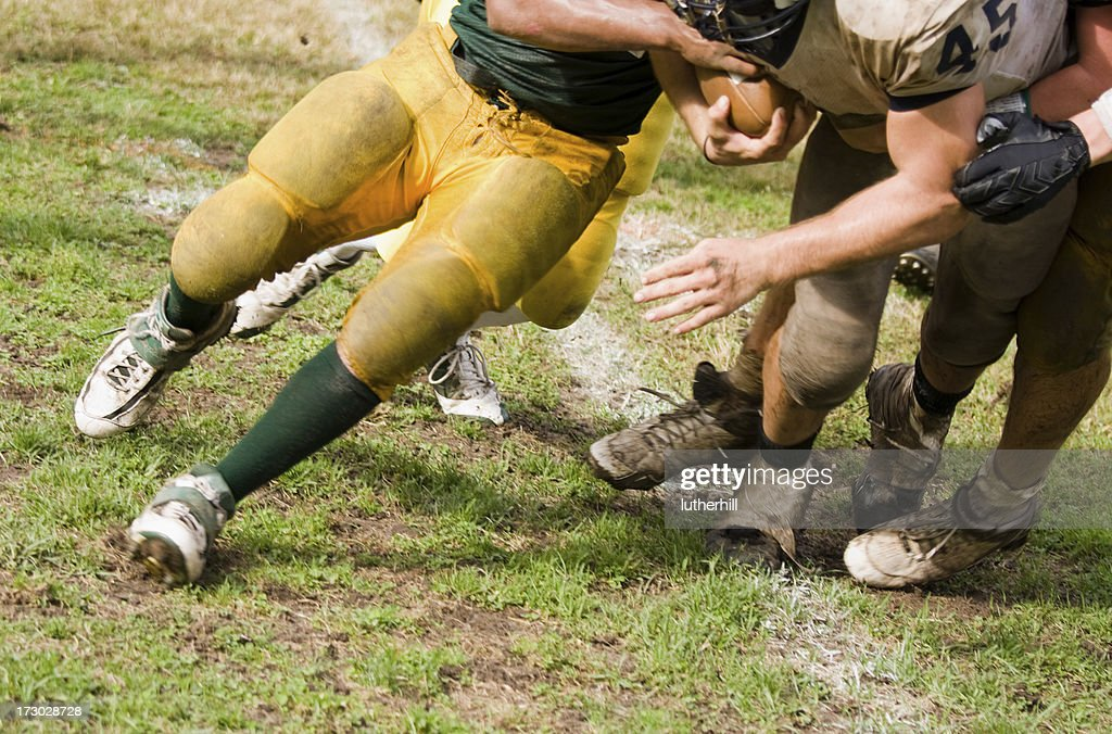 football running back being tackled