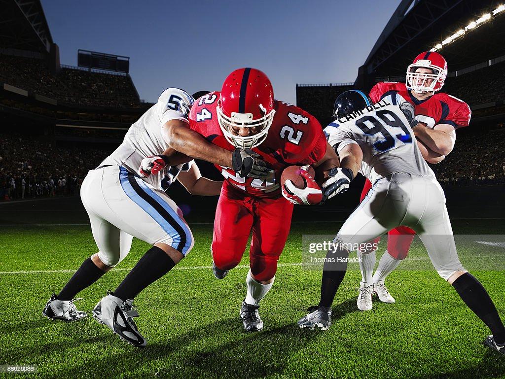 Football running back running through defendersh : Stock Photo
